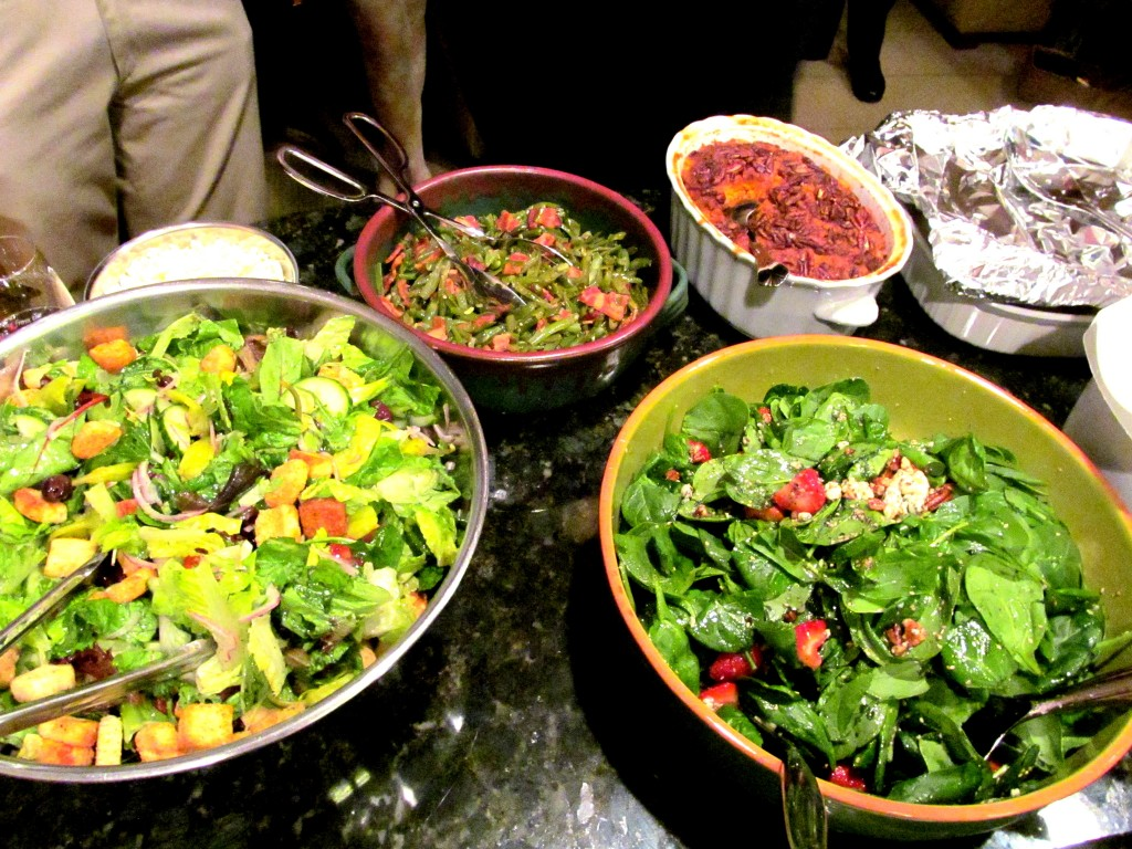 Caesar salad with olives/tomatoes, spinach salad with strawberries, green beans/bacon, sweet potatoes/candied pecans.