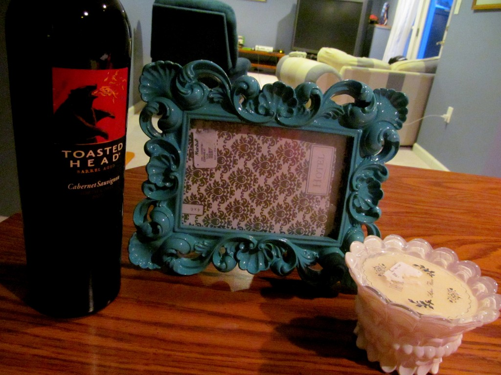 Toasted Head Cab, a picture frame (where I intend to put a pic of us), and a candle (very me).