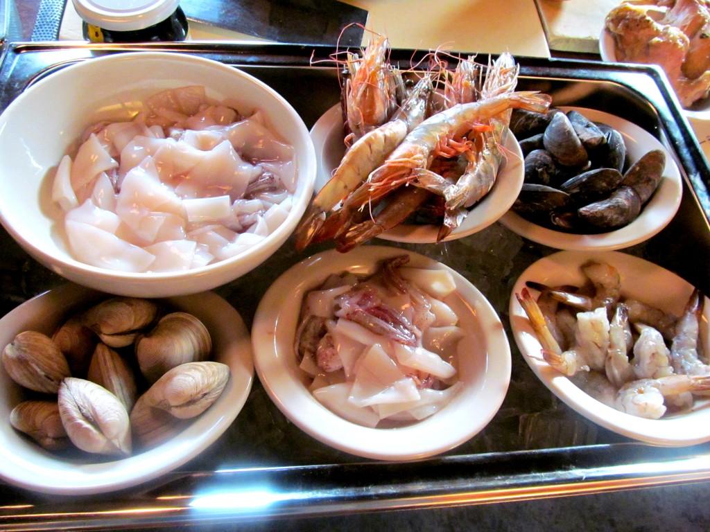 Mariscos paella ingredients: Prawns, Squid, Clams, Mussels