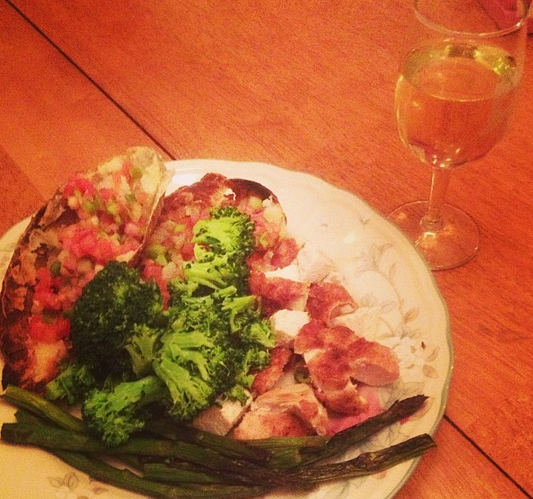 An amazing healthy dinner at home with a welcome glass of white wine.