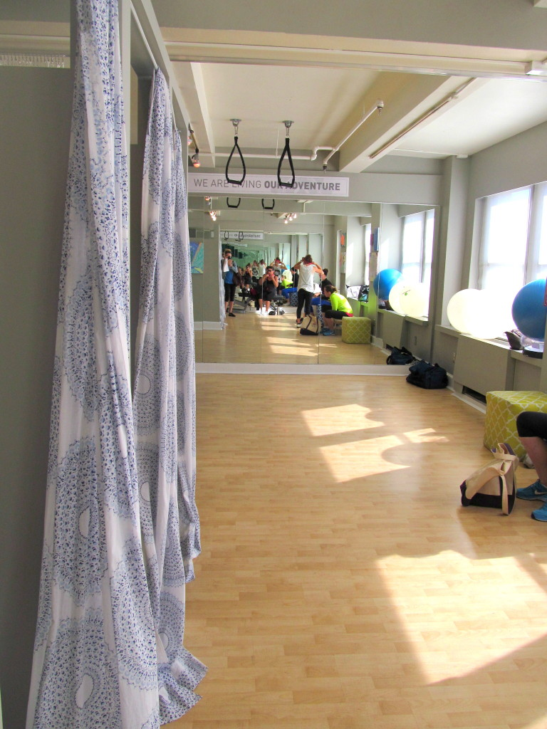 Plenty of space for personal training (also offered) and really pretty changing room curtains. Love the many windows.
