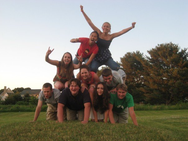 Yours truly topping the pyramid, and Kelly on the left with her tongue sticking out, at her high school grad party!