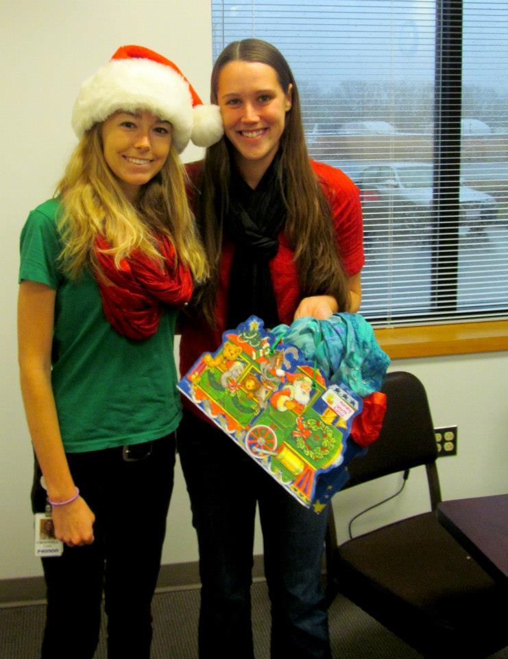 My co-worker Ashley and I during Secret Santa 2012. She's the one who is having a baby any second now!