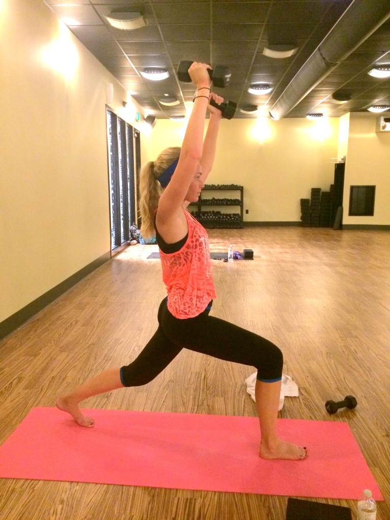 The beginning of the class starts with un-weighted sun salutations, and then we add weights. This is crescent pose.