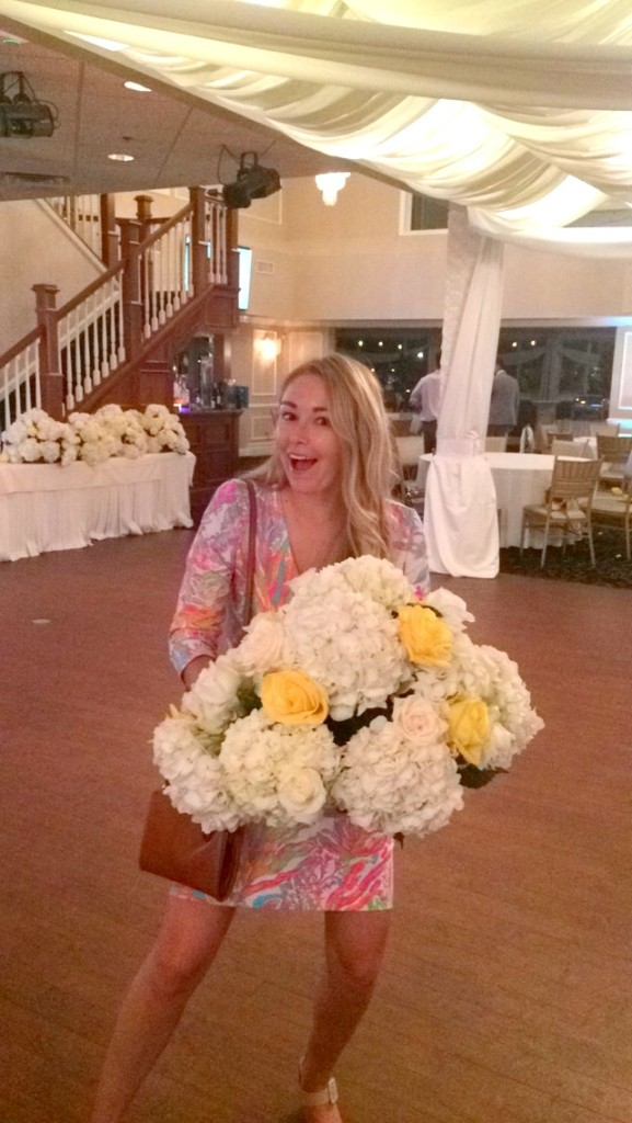 Who's this crazy chick stealing flowers?!